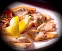 Geroosterde pitapuntjes met hummus